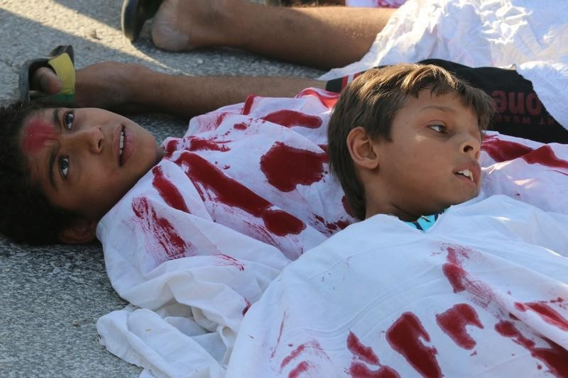 Aleppo child protest 2016 09 15T160904Z 1 MTZGRQEC9FJZLTEY RTRFIPP 0 MIDEAST CRISIS SYRIA AID
