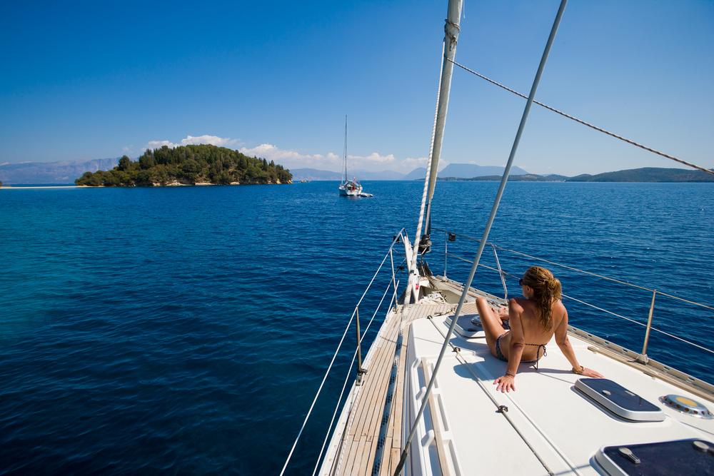 Woman sailing mediterranean