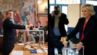 Γαλλικές εκλογές: Με χαμόγελα Μακρόν και Λεπέν στην κάλπη (pics&vids)