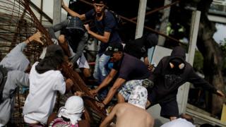 Χαοτική η κατάσταση στη Βενεζουέλα - Πυροβόλησαν αστυνομικό στο κεφάλι (pics)