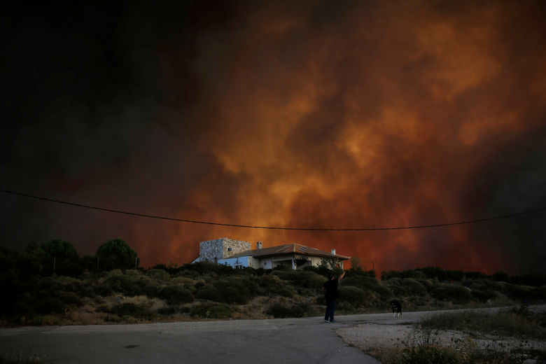 2017 08 14T093131Z 592375879 RC1B42D5DFC0 RTRMADP 3 GREECE WILDFIRE