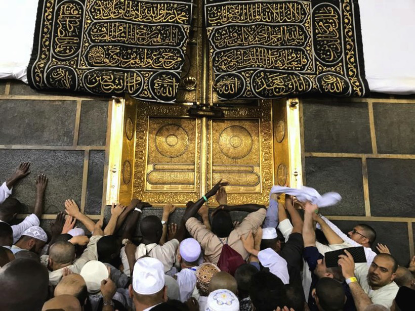 Muslims touch the Kaaba at the Grand to pay respect to Prophet Mohammad in Mecca. Source ReutersSuhaib Salem
