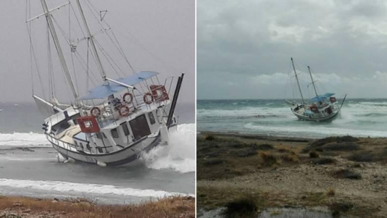 Ρόδος: Σκάφος παρασύρθηκε στη στεριά λόγω κακοκαιρίας (pics)