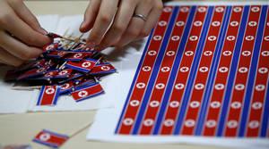 Οδοντογλυφίδες με τη σημαία της Βόρειας Κορέας.