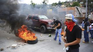 Ονδούρα: Αιματηρές συγκρούσεις με νεκρό πριν την ορκωμοσία Ερνάντες (pics)