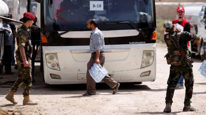 Χιλιάδες ένοπλοι εγκατέλειψαν τις νότιες περιοχές της Δαμασκού