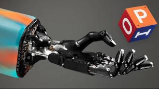 Ρομποτικό χέρι παίζει στα δάχτυλα έναν κύβο