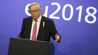 Επικρίσεις Γιούνκερ για την αποχώρηση της Αυστρίας από το Σύμφωνο για την Μετανάστευση