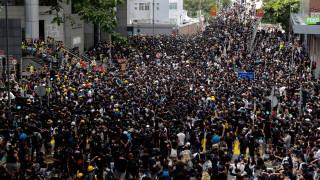 Χονγκ Κονγκ: Νέα ογκώδης διαδήλωση - Ζητούν το «κεφάλι» της Κάρι Λαμ