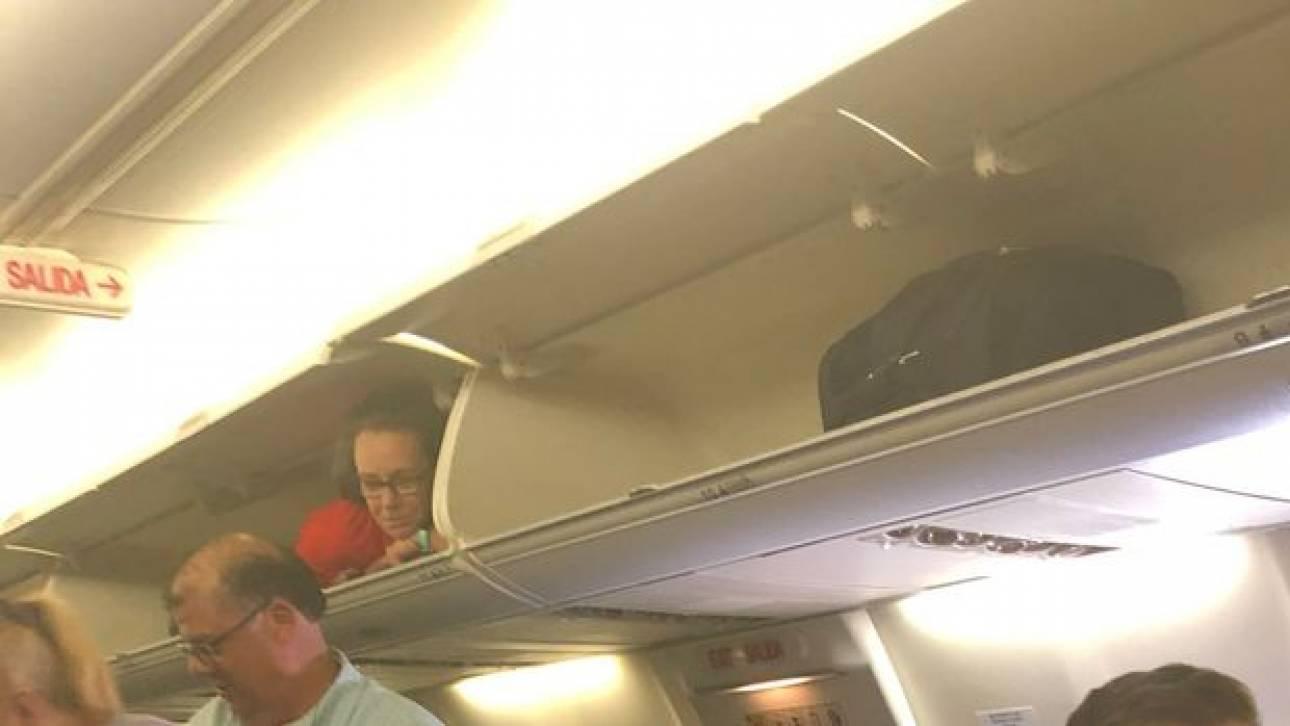 Ξεκαρδιστικό βίντεο: Αεροσυνοδός σφηνώθηκε στο… ντουλαπάκι των χειραποσκευών
