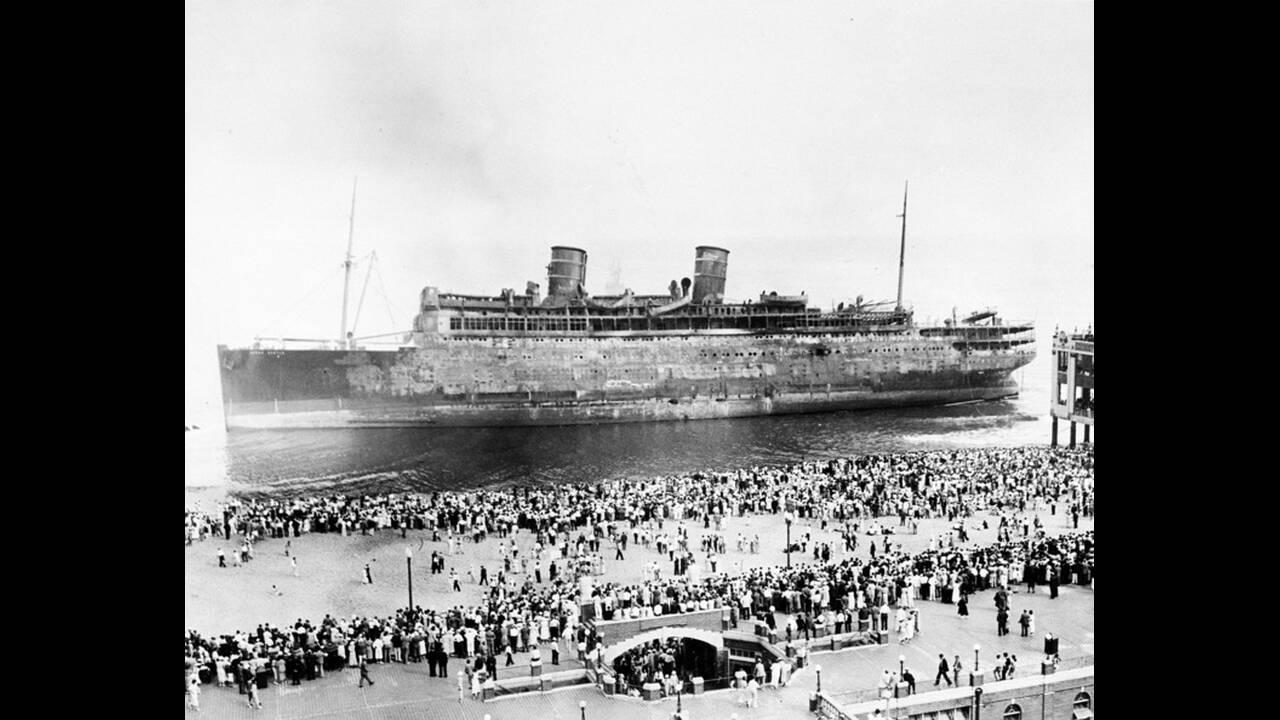 1934, Νιού Τζέρζεϊ. Χιλιάδες άνθρωποι συγκεντρώνονται στην παραλία του Άσμπουρι Παρκ, στο Νιού Τζέρζεϊ, για να δουν το  Morro Castle, ένα πολυτελές κρουαζιερόπλοιο, το οποίο πήρε φωτιά επιστρέφοντας από την Κούβα στη Νέα Υόρκη. Στη φωτιά έχασαν τη ζωή του